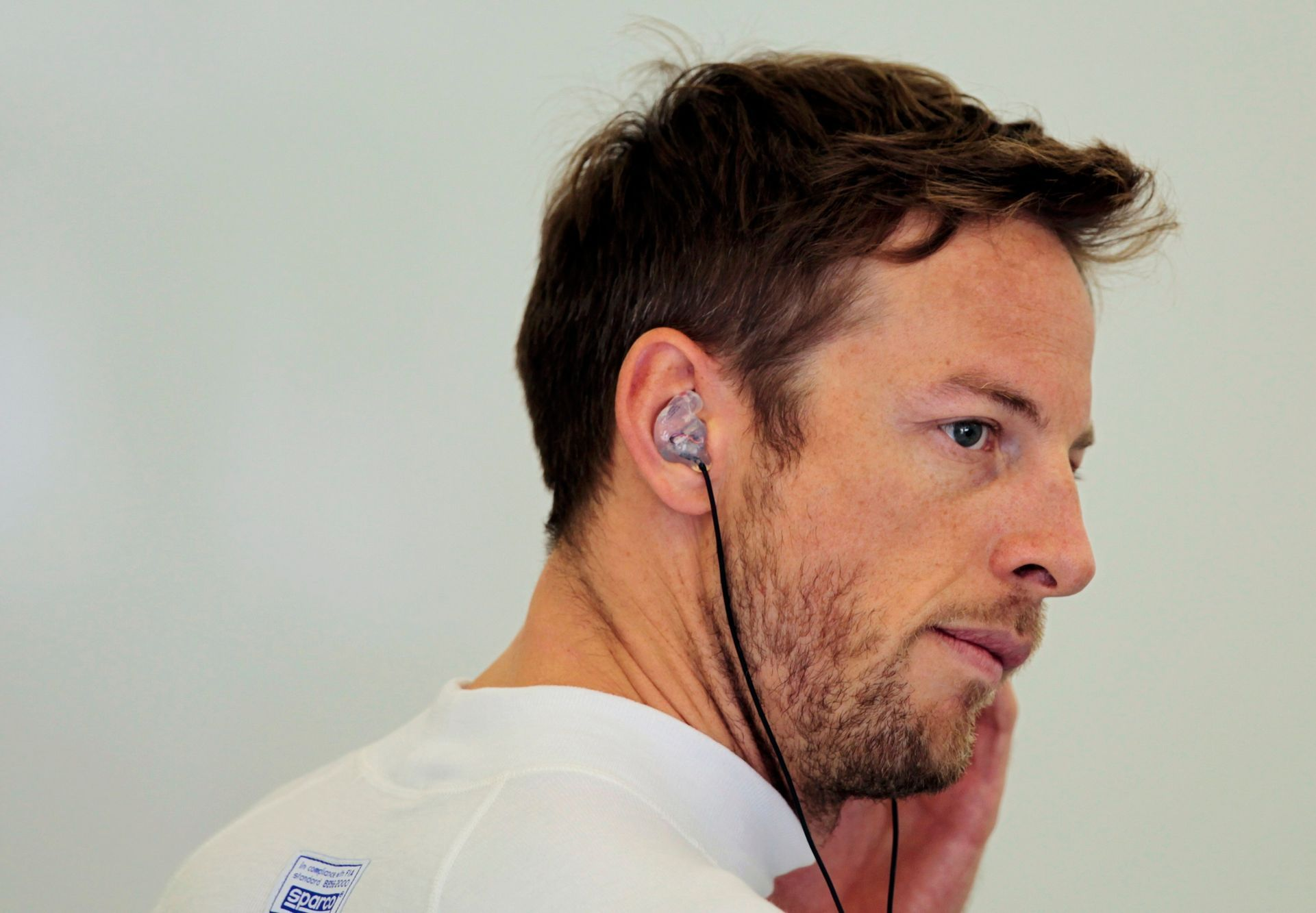 McLaren Formula One driver Jenson Button of Britain looks on during the first practice session of the Bahrain F1 Grand Prix at the Bahrain International Circuit (BIC) in Sakhir