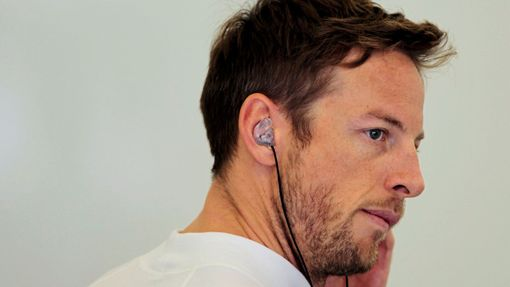 McLaren Formula One driver Jenson Button of Britain looks on during the first practice session of the Bahrain F1 Grand Prix at the Bahrain International Circuit (BIC) in