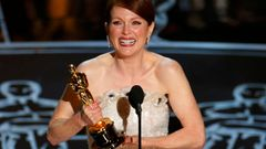 "Julianne Moore accepts the Oscar for Best Leading Actress for her role in ""Still Alice"" at the 87th Academy Awards in Hollywood, California"