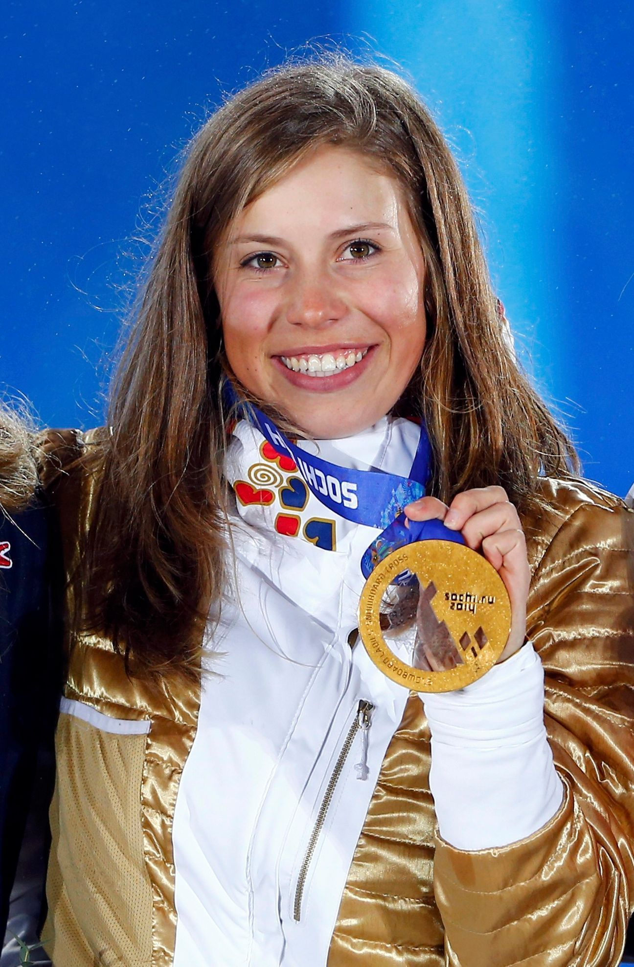 Gold medallist Eva Samkova of the Czech Republic poses during the victory ceremony for the women's snowboard cross competition at the 2014 Sochi Winter Olympics