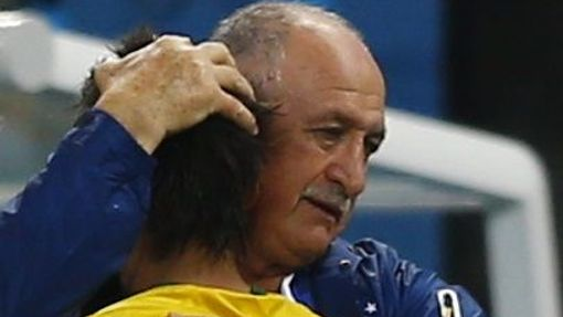 Brazil's coach Luiz Felipe Scolari hugs Brazil's Neymar during the 2014 World Cup opening match between Brazil and Croatia at the Corinthians arena in Sao Paulo June 12,