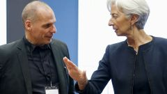 Greek Finance Minister Varoufakis listens to IMF Managing Director Lagarde during an euro zone finance ministers meeting in Luxembourg
