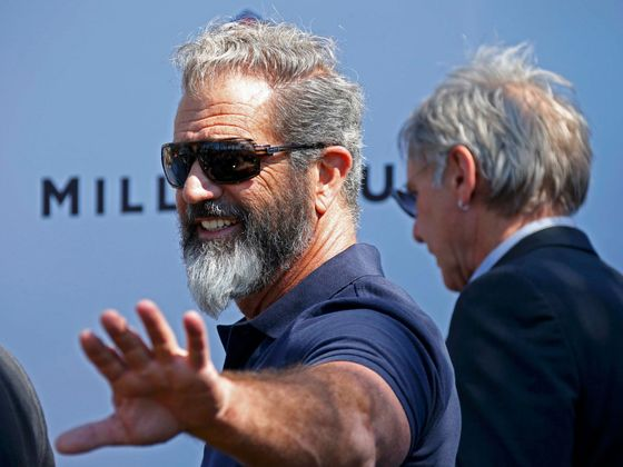 "Cast members Mel Gibson and Harrison Ford pose  during a photocall on the Croisette to promote the film ""The Expendables 3"" during the 67th Cannes Film Festival in Cannes"