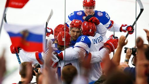 Russia's Sergei Plotnikov (16) celebrates with team mates his goal against Sweden during the first period of their men's ice hockey World Championship semi-final game at