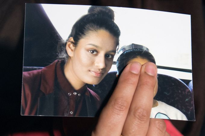 FILE PHOTO: Renu Begum, sister of teenage British girl Shamima Begum, holds a photo of her sister as she makes an appeal for her to return home at Scotland Yard, in Londo