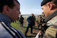 Ukrainian soldiers talk to pro-Russia protesters in the field near Kramatorsk, in eastern Ukraine April 16, 2014.