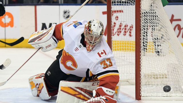 Jan 16, 2020; Toronto, Ontario, CAN;   Calgary Flames goalie David Rittich (33) makes a save against Toronto Maple Leafs in the third period at Scotiabank Arena. Mandator