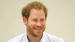 Prince Harry chats with staff during his visit to the Burrell Street Sexual Health Clinic in London.