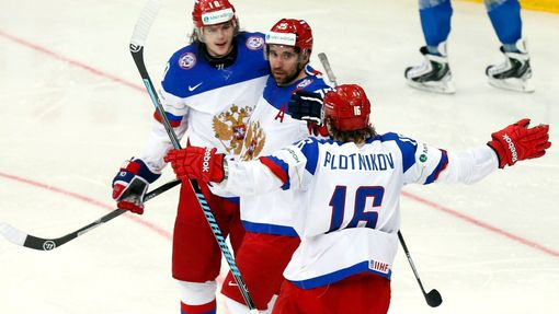 Russia's Danis Zaripov (C) celebrates his goal against Kazakhstan with team mates Sergei Plotinikov (R) and Viktor Tikhonov during the second period of their men's ice ho