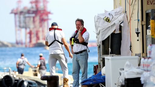 Salvage master Nick Sloane (R) talks on his mobile phone before boarding Costa Concordia cruise liner during the refloat operation at Giglio harbour at Giglio Island July