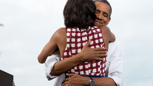 "Aug. 15, 2012 ""The President hugs the First Lady after she had introduced him at a campaign event in Davenport, Iowa. The campaign tweeted a similar photo from the campaign photographer on election night and a lot of people thought it was taken on election day"