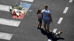 A makeshift memorial placed on the road during a minute of silence in Nice