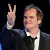 US director Quentin Tarantino flashes a victory sign as he arrives on the stage during the 39th Cesar Awards ceremony in Paris
