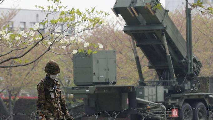 A Japan Self-Defence Forces soldier stands guard near Patriot Advanced Capability-3 (PAC-3) missiles at the Defence Ministry in Tokyo April 9, 2013. Japanese public broad