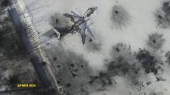 Still image taken from handout aerial footage shot by drone shows outline o airplane in the snow at the Sergey Prokofiev International Airport damaged by shelling during fighting between pro-Russian s