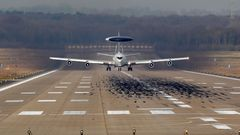A NATO AWACS aircraft takes-off for a flight to Poland from the AWACS air base in Geilenkirchen
