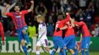 CSKA Moscow's Keisuke Honda walks past Viktoria Plzen's Marian Cisovsky and his teammates celebrating after their Champions League soccer match in Plzen