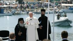 Pope Francis delivers his address at the port of Lesbos during his visit the Greek Island of Lesbos