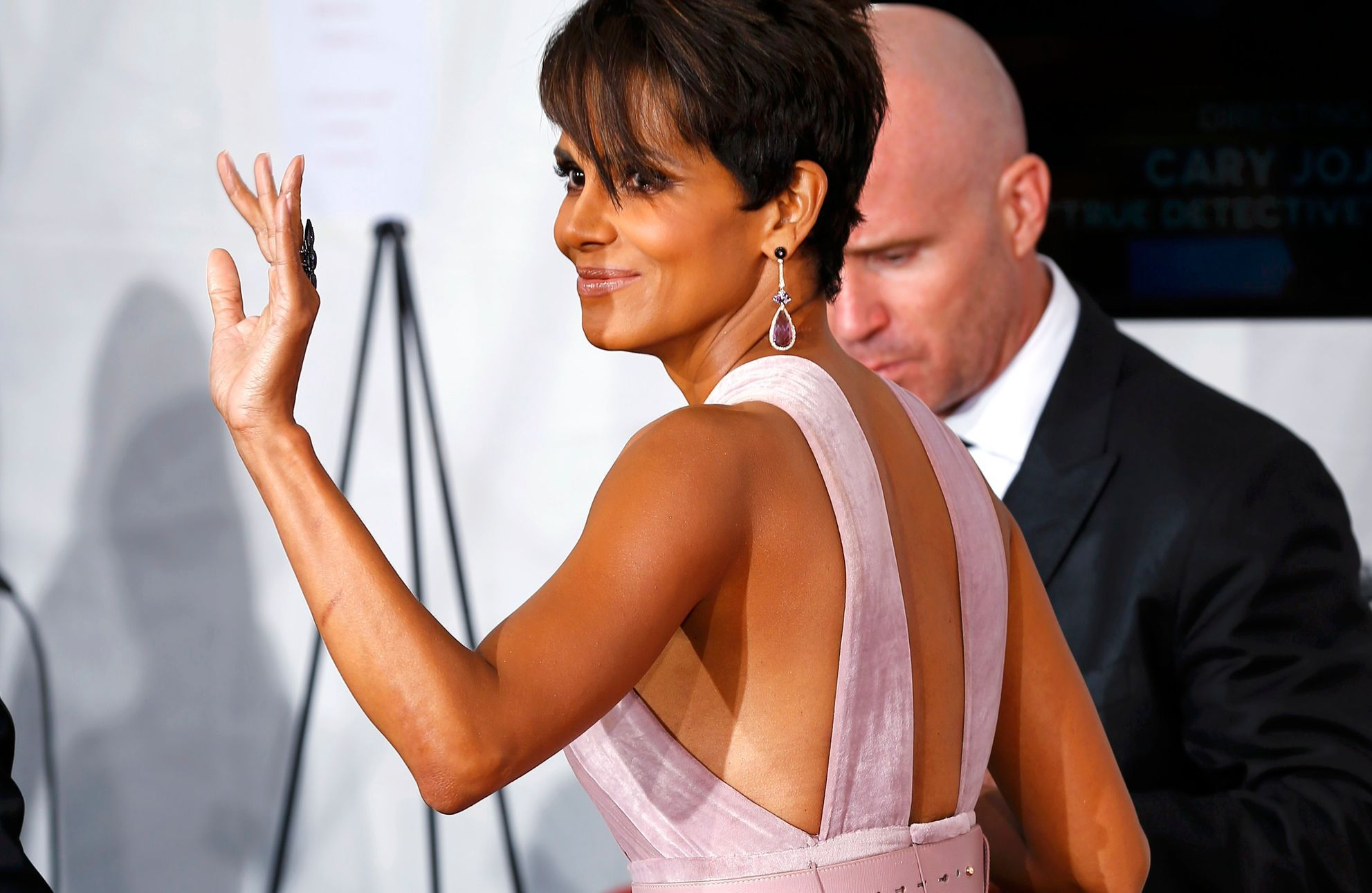 Halle Berry leaves backstage at the 66th Primetime Emmy Awards in Los Angeles