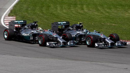 Mercedes Formula One driver Nico Rosberg of Germany (R) cuts inside Mercedes Formula One driver Lewis Hamilton of Britain on the start during the Canadian F1 Grand Prix a