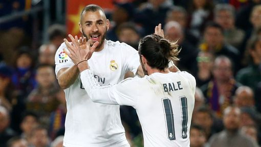 Real Madrid's Karim Benzema celebrates scoring their first goal with Gareth Bale