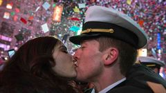 A couple kisses amid confetti as the clock strikes midnight during New Year's Eve celebrations in Times Square, New York