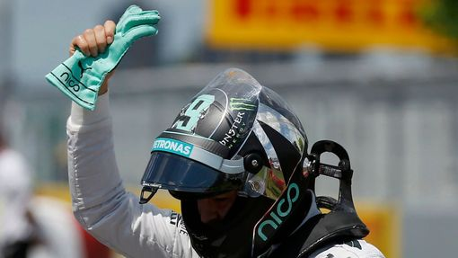 Mercedes Formula One driver Nico Rosberg of Germany celebrates after winning the pole position during the qualifying session of the Canadian F1 Grand Prix at the Circuit