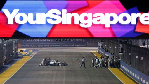 Mercedes Formula One driver Nico Rosberg of Germany has his car pushed back to the pit lane just before the start of the Singapore F1 Grand Prix at the Marina Bay street