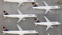 File aerial photo shows Lufthansa planes parked on the tarmac of the closed Frankfurt's airport