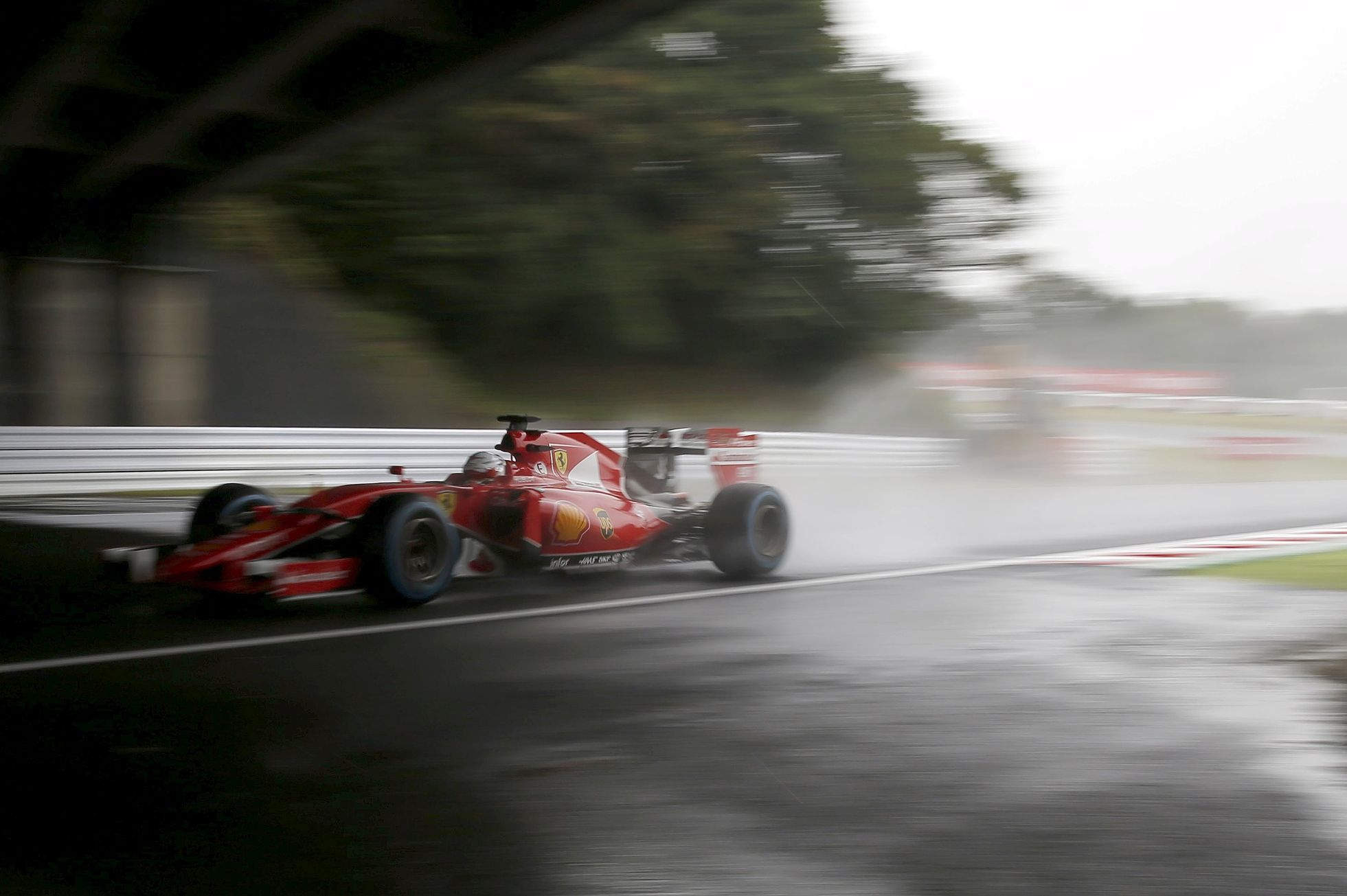 Ferrari Formula One driver Vettel of Germany drives during the second practice session in Suzuka