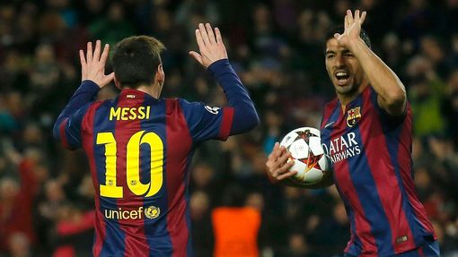 Barcelona's Lionel Messi celebrates with team-mate Luis Suarez after scoring a goal against Paris St Germain during their Champions League Group F soccer match at the Nou