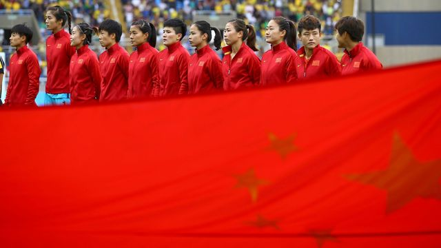 People's Republic of China's squad before the beginning of the match.