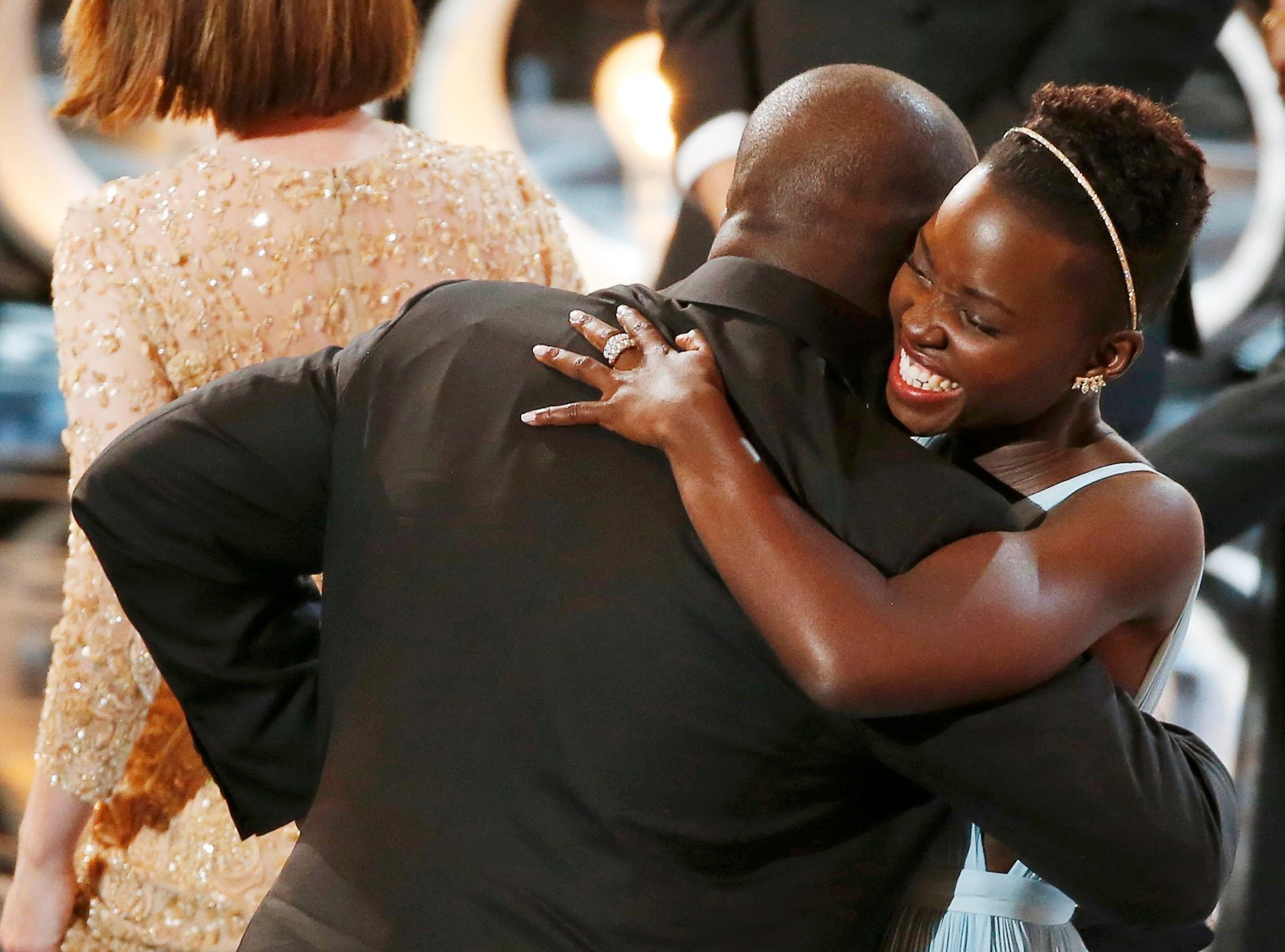 Director and producer McQueen celebrates with the Nyong'o after accepting the Oscar for best picture at the 86th Academy Awards in Hollywood