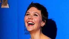 Maggie Gyllenhaal poses with her award during the 72nd Golden Globe Awards in Beverly Hills
