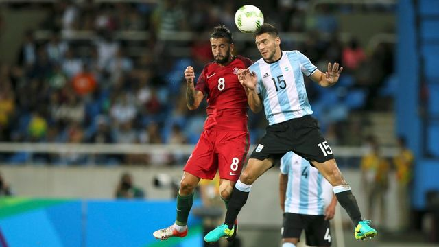Sergio Oliveira (POR) of Portugal (L) and Lisandro Magallan (ARG) of Argentina (R) compete for the ball.