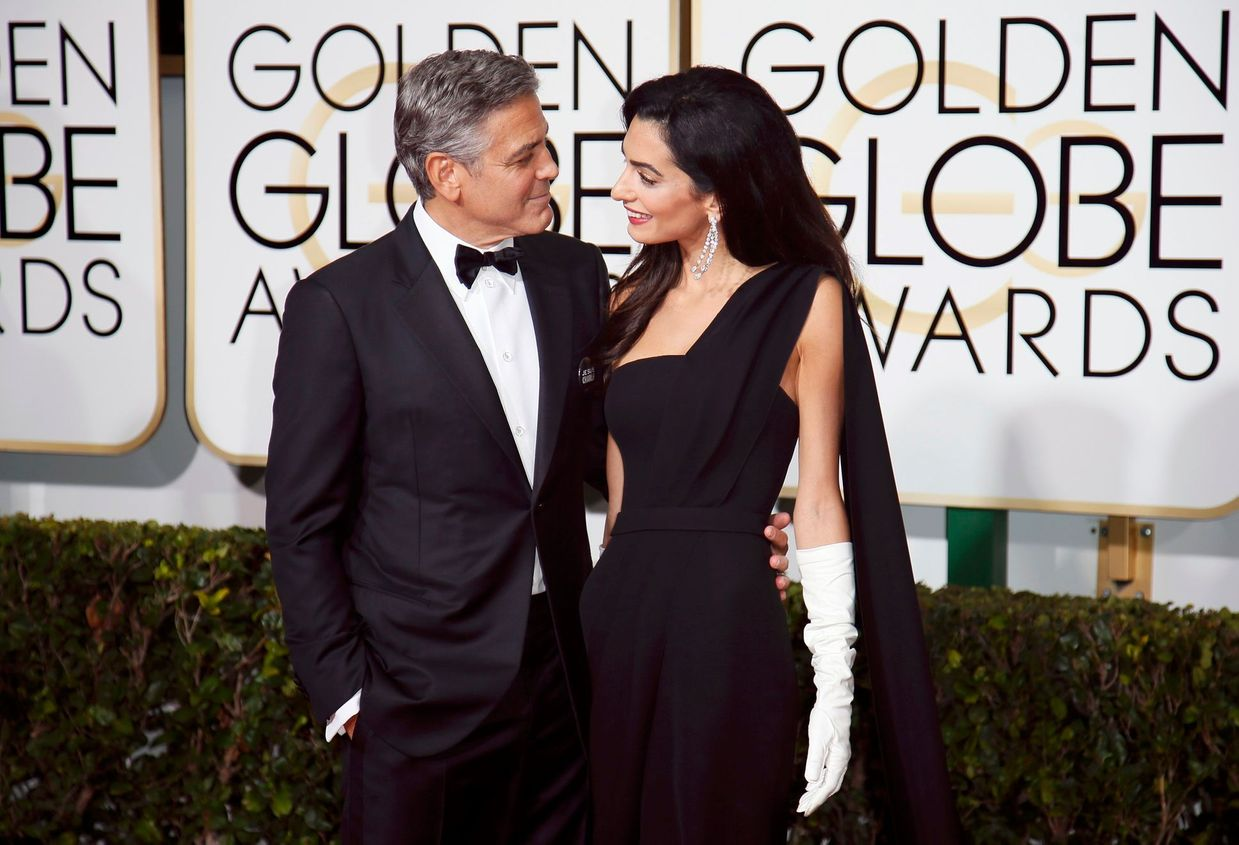 George and Amal Clooney arrive at the 72nd Golden Globe Awards in Beverly Hills