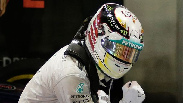 Mercedes Formula One driver Lewis Hamilton of Britain celebrates atop his car after winning the Singapore F1 Grand Prix
