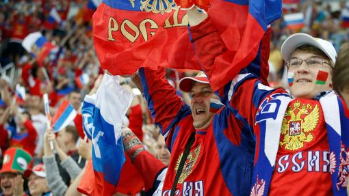Russia's fans cheer during the first period of their men's ice hockey World Championship final game against against Finland at Minsk Arena in Minsk May 25, 2014. REUTERS/