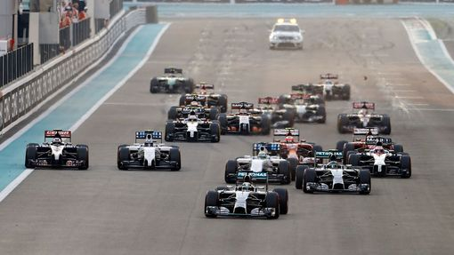 Mercedes Formula One driver Lewis Hamilton of Britain leads the pack as they approach the first turn during the Abu Dhabi F1 Grand Prix at the Yas Marina circuit in Abu D
