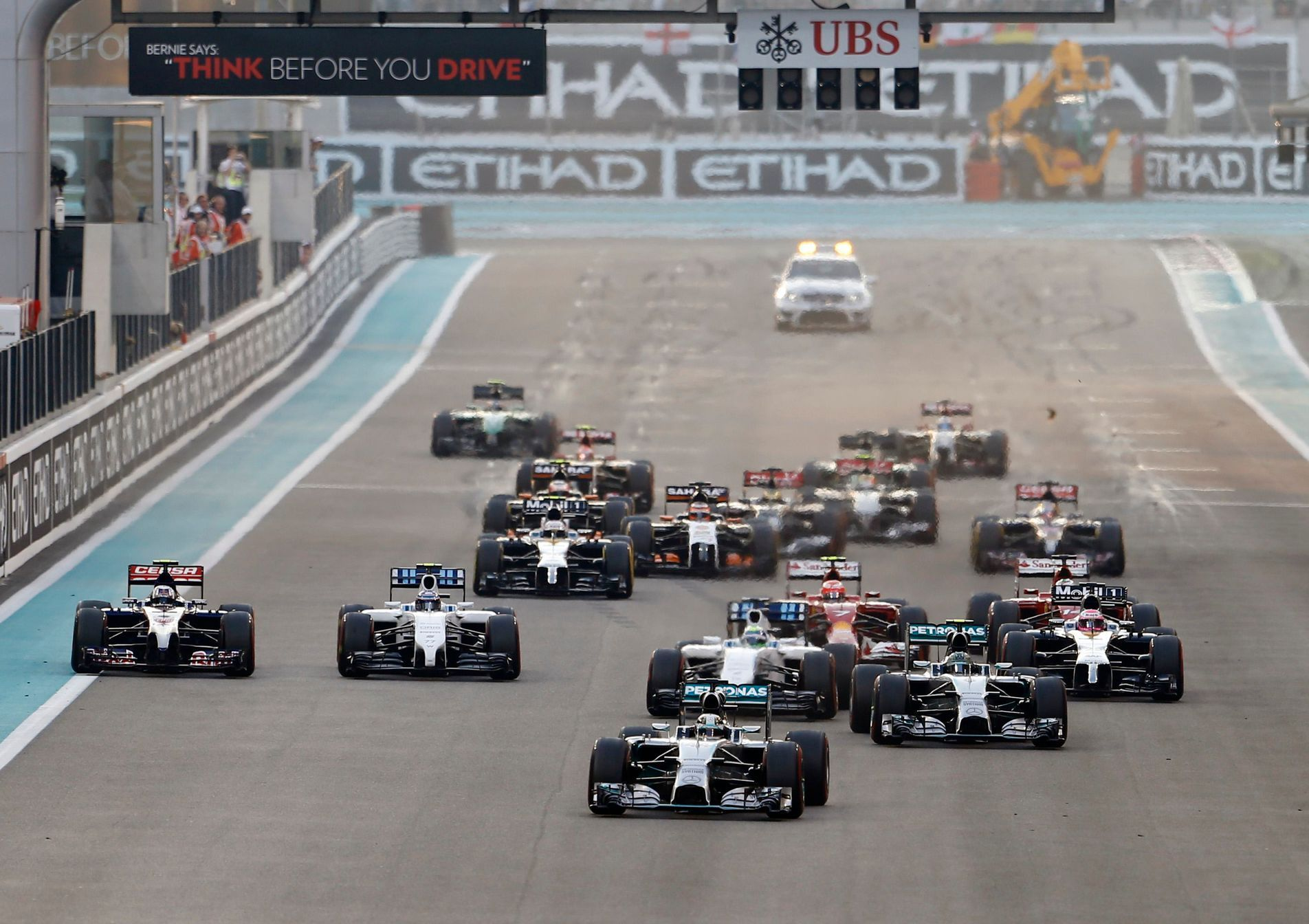 Mercedes Formula One driver Lewis Hamilton of Britain leads the pack as they approach the first turn during the Abu Dhabi F1 Grand Prix at the Yas Marina circuit in Abu Dhabi