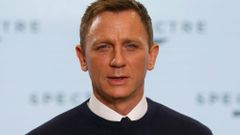 "Actor Daniel Craig poses on stage during an event to mark the start of production for the new James Bond film ""Spectre"" at Pinewood Studios"