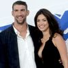 Michael Phelps a Nicole Johnsonová